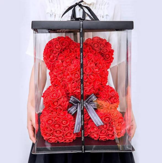 a red rose teddy bear in a box