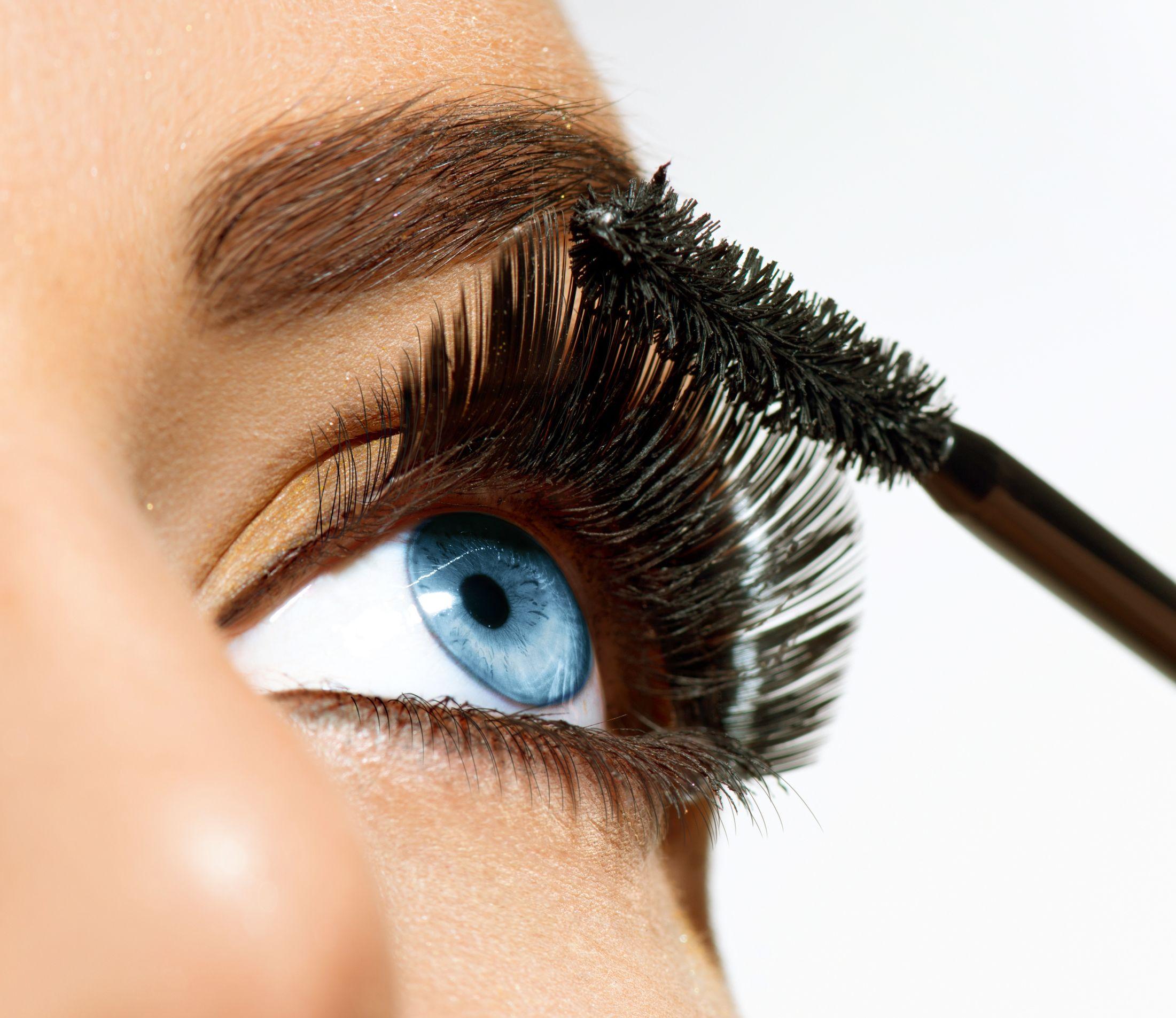 21386666 - mascara applying long lashes closeup ...